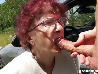Kinky granny gives a blowjob and tugjob to four spoiled young guy