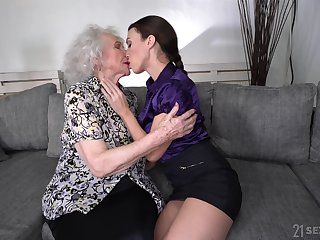 Young lesbian Tiffany Wholesale is licking pussy of good anticipating granny